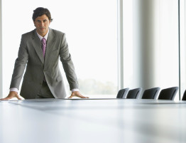 Businessman in Conference Room --- Image by © Royalty-Free/Corbis